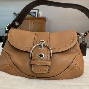 Tan coach shoulder bag.